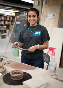 Esperanza Gomez creates clay coils during Ceramics I