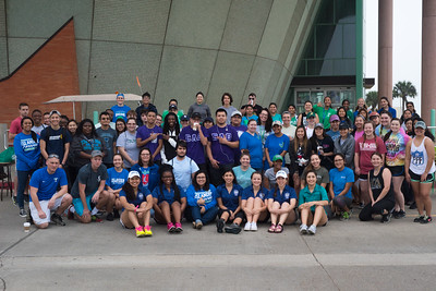 Students taking part in the Islander Spring Clean event pose for a group photo after setting out across the campus to collect trash in advance of Homecoming Week.