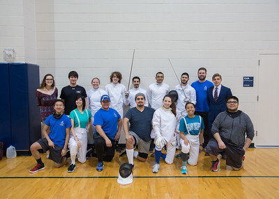 The Fencing Club poses for a group photo before embarking on the first fencing tournament held on campus, which included several other universities.