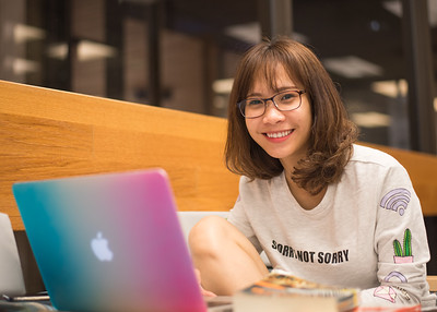 Hau Nguyen studies for an upcoming test in the Mary and Jeff Bell Library.