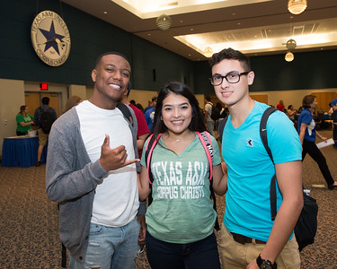 Allen Graham (left), Brenda Castillo and Rodolfo Dehoyos pause for a photograph during the Tip Off Picnic in the University Center.