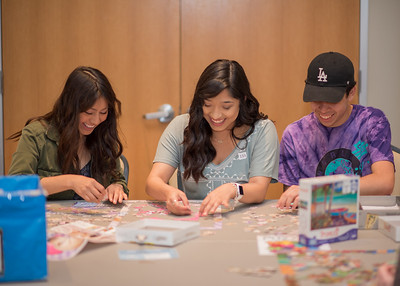 Giselle Guzman (left), Daisy Garcia, and Sam Trujillo work on puzzles together during Paws on the Island.
