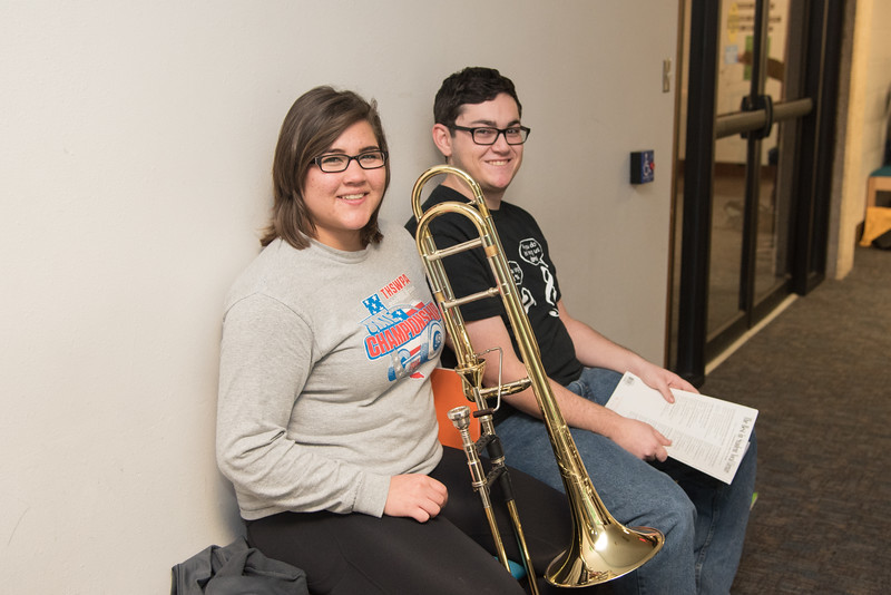 Annalyn Ngo (left) waits patiently for her audition, while Jordan Kuzmack studies for his Symphonic Winds class.