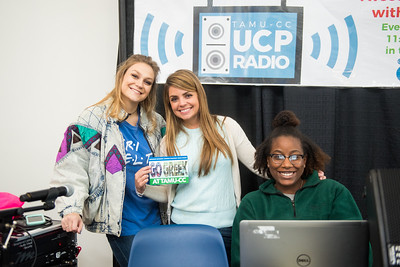 Jordyn McDaniel (left), Mahogany Tas, and Autumn Redmon from TAMUCC University Center & Student Activities, assist with the music played during the Meet the Greeks event in the University Center Rotunda.