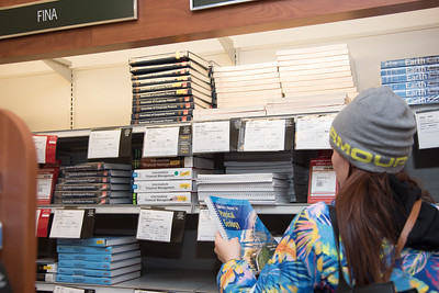 Islander student Katelyn Genach picks up her Geology book from the Barnes & Noble at TAMU-CC.
