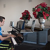 Louis Chavez practices piano in the University Center Tejas Lounge.