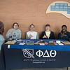Jacob Ammerman, Nath Callihan, Joe Spencer, William Baldeschwiler, & McAllen Waobikeze show their Islander pride at their recruitment booth for Phi Delta Theta.