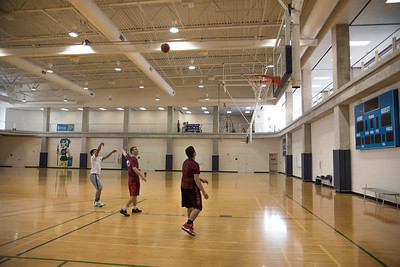 Issac Neyra (left), Ricardo Salinas, & John Friesen-Lee play basketball in the Dugan Wellness Center.