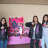 Sofia Flores (left), Micaela Hernandez & Ashley Ventura pose at their recruitment table for Sigma Lambda Gamma.
