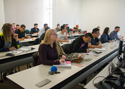 Student Kelsey Durham listens to Dr. Armand Picou's lecture during Intermediate Corporate Finance.