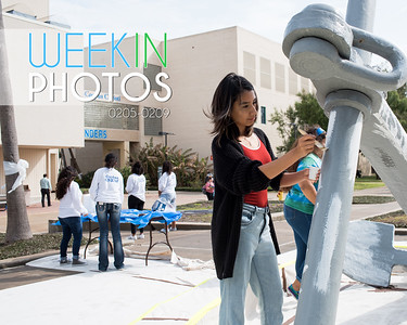 Paola Lopez takes part in painting the anchor in front of the University Center during the Homecoming tradition called Anchors Aweigh.   Click on the link for more information on upcoming Homecoming events: http://bit.ly/18fYq5V