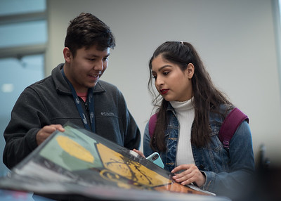 Students Alex Carbajal (left) and Desirae Galvan browse through posters at the Poster Sale located at the University Center.
