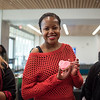 KeAnna Whisenhunt shows off the cookie she decorated at Campus Activities Board's Valentine's Day Coffeehouse event.