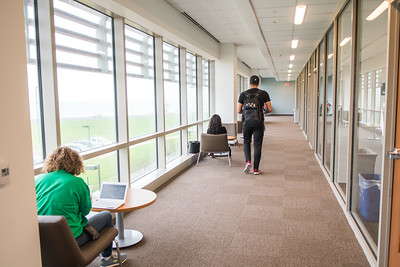 Students study on the second floor in the Michael and Karen O'Connor Building.