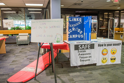 The Mary and Jeff Library showcases different posters and organizations that help with mental health awareness.