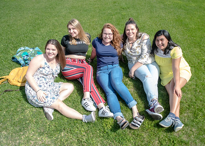 Sarah Batzer (left), Kate Wilson, Kat Williams, Cat Sage and Jazmine Lara enjoy a beautiful day back on campus.