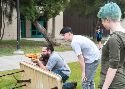 Tommy Reyna (left),  Colten Warren, and Sam Ellingsworth attempt the Nerf Gun Obstacle Challenge on East Lawn, hosted by the Student Veterans Organization - Texas A&M Corpus Christi.