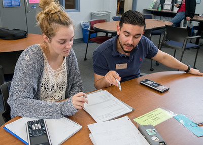 Stevan Davila, math tutor at the Center for Academic Student Achievement (right), helps Halle Ford with her Calculus 2 studies.  For more info on CASA's services: http://bit.ly/1hswXLM
