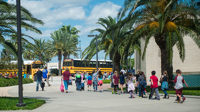Middle school students return to their buses after touring the Island University.