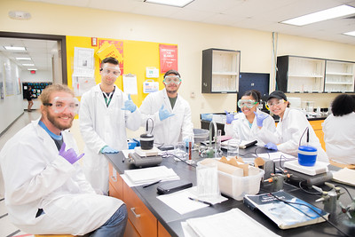 Kyle Jackson (left), Jordon Cabral, Michael Perez, Marissa McClure, and Dejah Meredith-Davis show off their best shakas during a Chemistry Lab.
