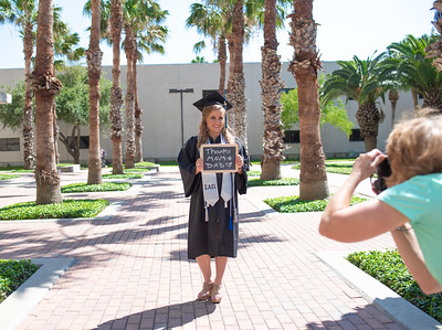 Taylor Brown poses for graduation photos as she prepares to finish her semester as an undergraduate.