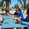Patrise Bryant (left), Lauren Pack, and Maame Twwmasi enjoy a chat outside on a beautiful Thursday afternoon
