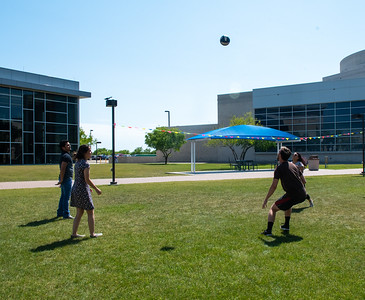 Sofia Rodriguez, Draven Reyes, Jacqueline Bird, and Garrett Swenson set up a game of volleyball on the East Lawn on a warm spring afternoon.