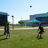 Sofia Rodriguez (left), Draven Reyes, Jacqueline Bird, and Garrett Swenson get together at the East Lawn to play volleyball as they enjoy a sunny fresh day out on campus after classes