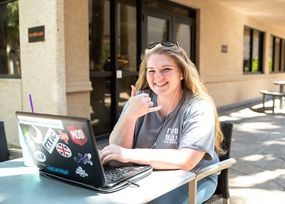 Allison Francis works on her Anatomy and Physiology assignments at the patio outside of Starbucks.