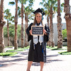 Taylor Brown poses for graduation photos as her last semester comes to an end