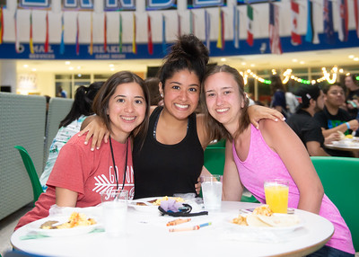 Gen Flores (left), Mel Flores, and Shawnee Ingram stop by for a meal during Late Night Breakfast held in the University Center.  Check out other events happening during the week of finals: https://adobe.ly/2jsnvSu