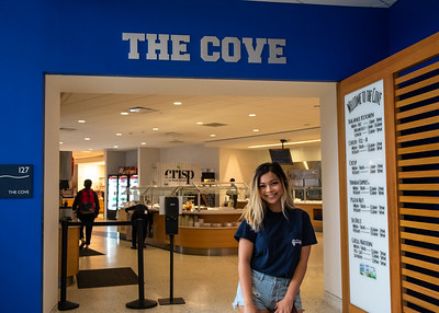 Mikaela Mendra pauses for a photo as she stops by The Cove located in the University Center.