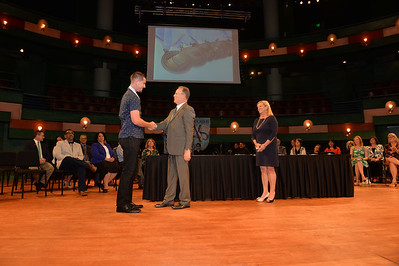 Student, Juan Zepata (left), is congratulated by Dean David Scott during the Spring 2018 College of Education and Human Development Induction Ceremony.