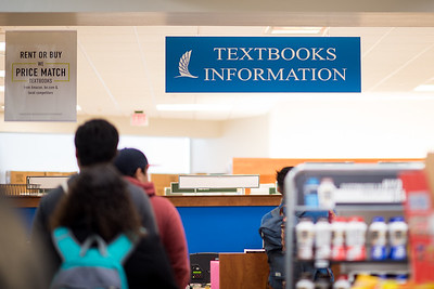 Students wait in line as they pick up their books for the spring semester.