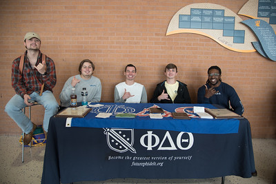 Jacob Ammerman, Nath Callihan, Joe Spencer, William Baldeschwiler, & McAllen Waobikeze show their Islander pride at their recruitment booth for @pdttxrho.