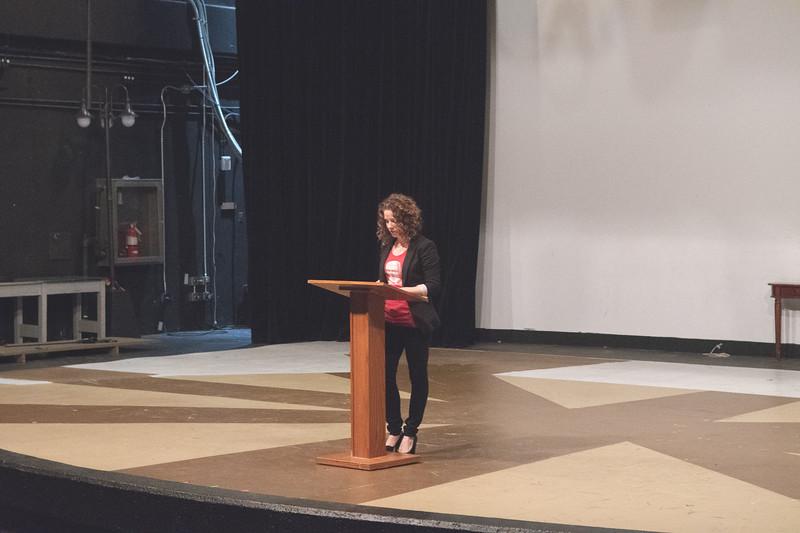 Professor Santos prepares to introduce Speaker Michael Saeugel in the Cednter of Arts Warren Theatre