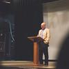 Michael Saeugel speaks to student son behalf of William Shakespeare's birthday in the Center of Arts Warren Theatre