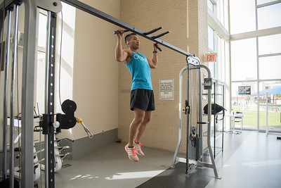 Christian Stacrs utilizes equipment in the Dugan Wellness Center.