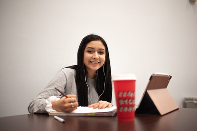 Samantha Sanchez brainstorms for her communication presentation in the Faculty Center as she finishes her last semester this spring.