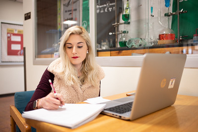 Psychology major Danielle Perez works on her statistics assignment after class at the Center for the Sciences.