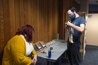 Kat Sage on the left and Tyler Lewis are preparing microphone packs for rehersals in the Center of the Arts.