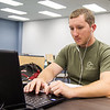 Student Jaran Garner studies for his summer I physics class in the Mary and Jeff Bell Library.