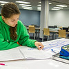 Student Kennah Lear studies for her kinesiology course, exercise testing and prescription in the Mary and Jeff Bell Library