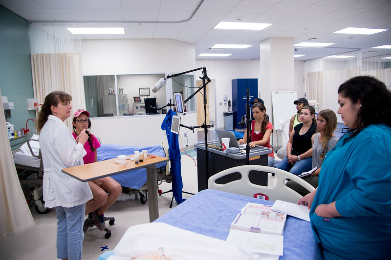 TAMUCC Nursing students are actively paying attention while Professor Catherine Harrel goes through different procedures.
