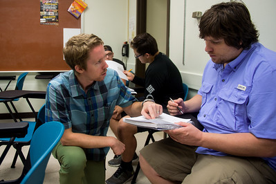 Dr. Jordan Alexander assists a student with a Trigonometry assignment in the Center for the Sciences.