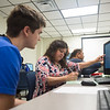 Academic adviser meet with students one on one, during new student orientation to help them make a schedule for their first semester at Texas A&M-Corpus Christ.