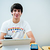 Student Dylan Olsen pauses for a photo as he studies for his physics exam in Bay Hall.