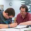 Robert D'Antonio (left) and his dad are reviewing for the strictly exam of chemistry