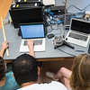 Noah Johnson (left), Luis Hernandez, and Camille Felgenhaver work on a experiment in University Physics II on July 26, 2017