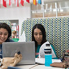 Bianca Coriez (left) and Paola Lopez  are working on their microbiology